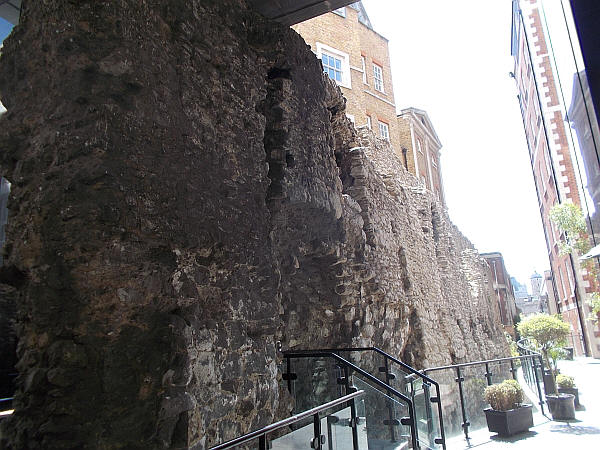 The amazing London wall in Coopers row, with the Crescent in the background - in May 2019